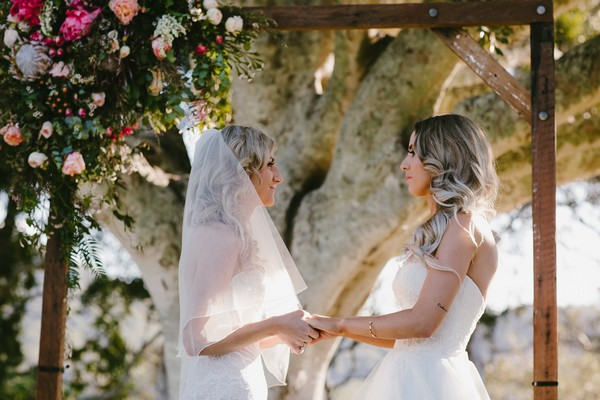Bride facing each other during wedding ceremony