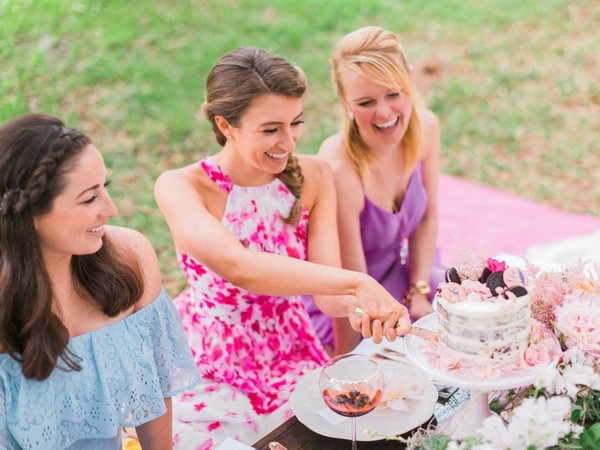 Girl cutting her Oreo hen party cake