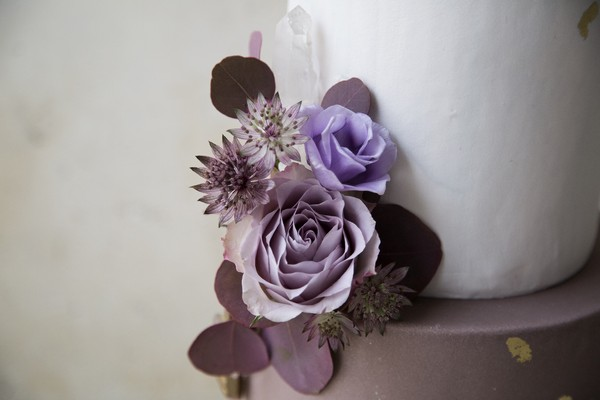 Purple flowers on wedding cake