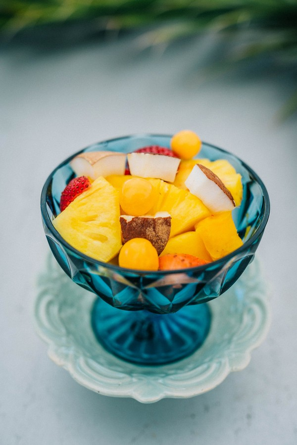 Tropical fruit in blue bowl