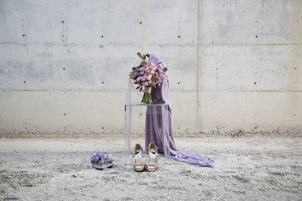 Purple bridal bouquet on Ghost chair