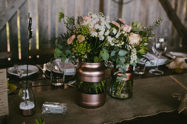 Glass and copper vases of flowers