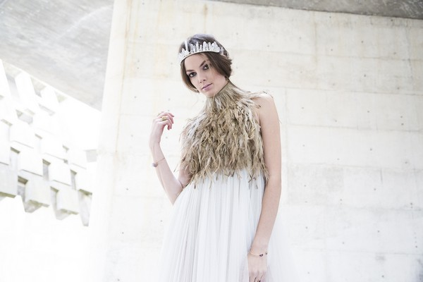 Bride wearing feather collar bridal neckpiece