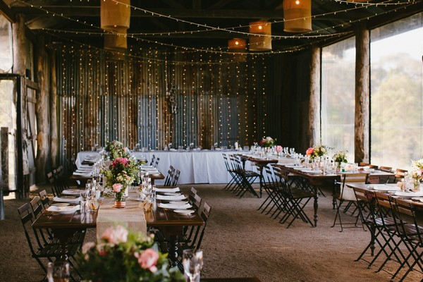 Tables in Yandina Station Dairy Barn for wedding reception