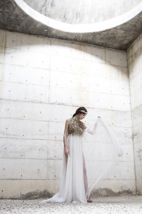 Bride pulling up train on dress