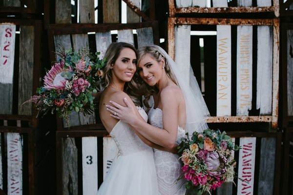 Two brides posing for picture