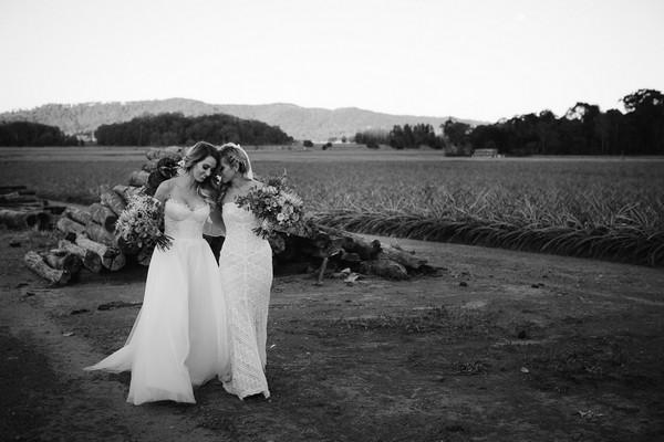 Two brides walking together