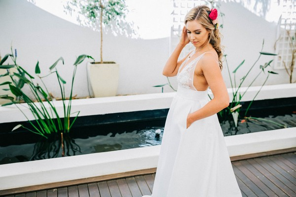 Bride with hand in pocket