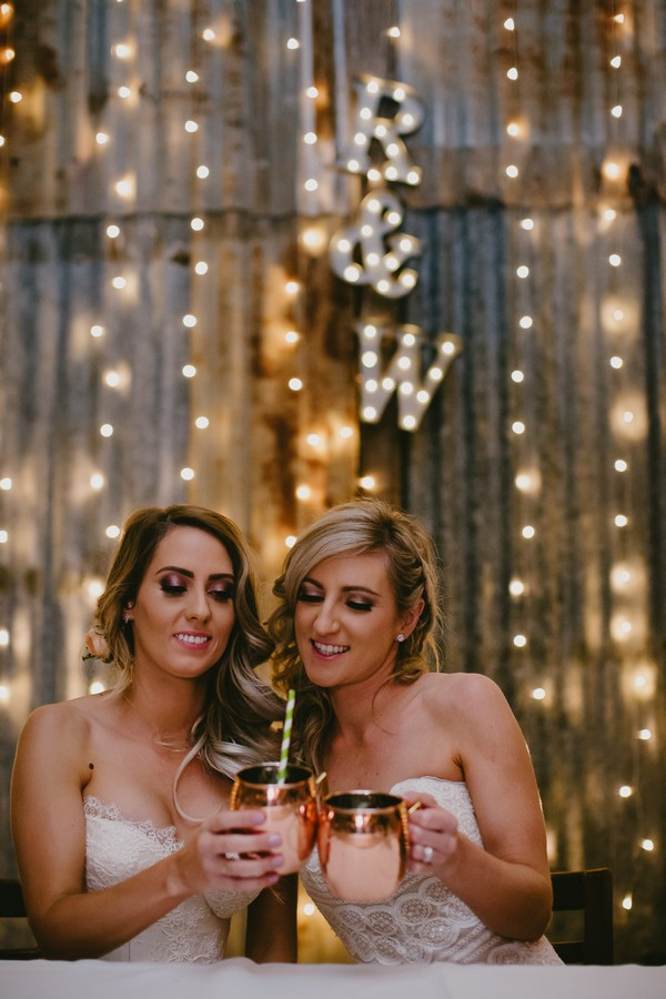 Brides having drink