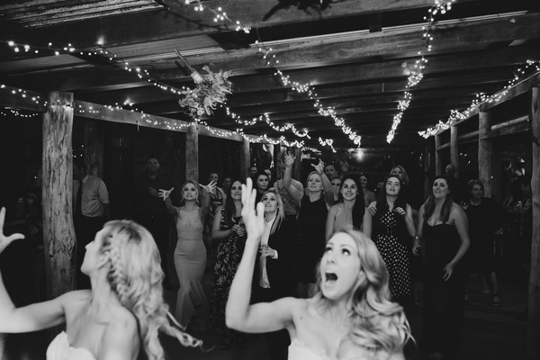 Brides throwing bouquets