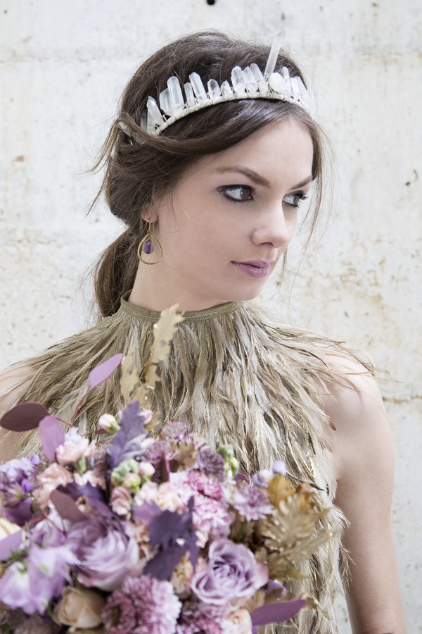 Bride wearing feather collar bridal neckpiece and feather crown