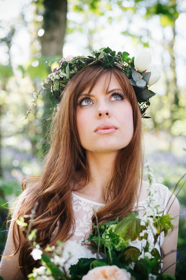 Bride with foliage crown looking up