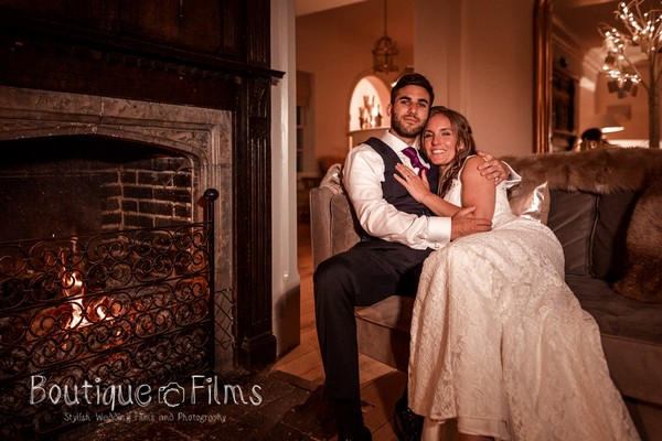 Bride and Groom Sitting Next to That Amazing Place Fireplace