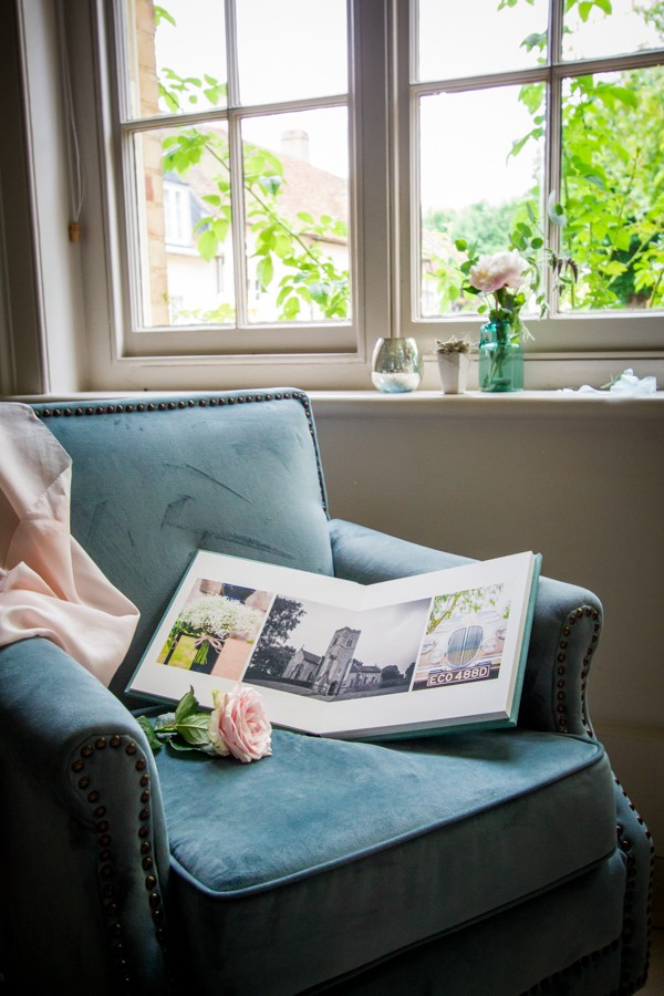 Wedding Photo Album Open on Chair Showing Pictures Inside