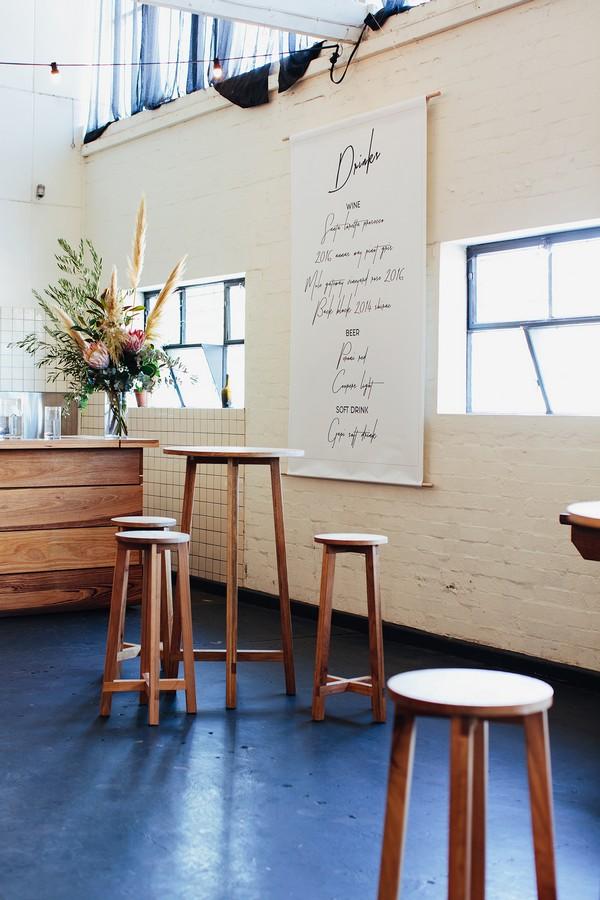 Large drinks menu list on wall