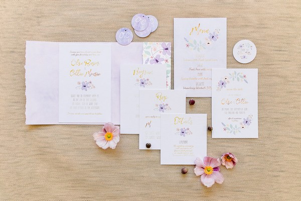 Violet and gold wedding stationery