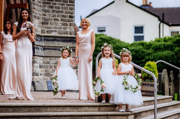 Bridesmaids and flower girls on steps of church