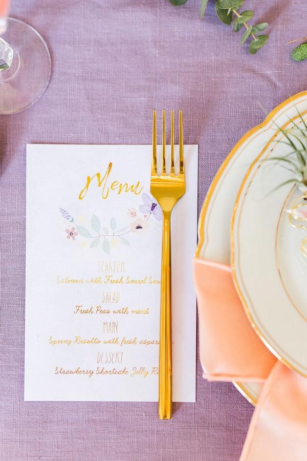 Gold fork on wedding menu