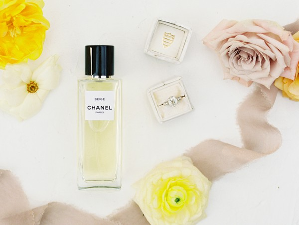 Chanel perfume, wedding ring and flowers