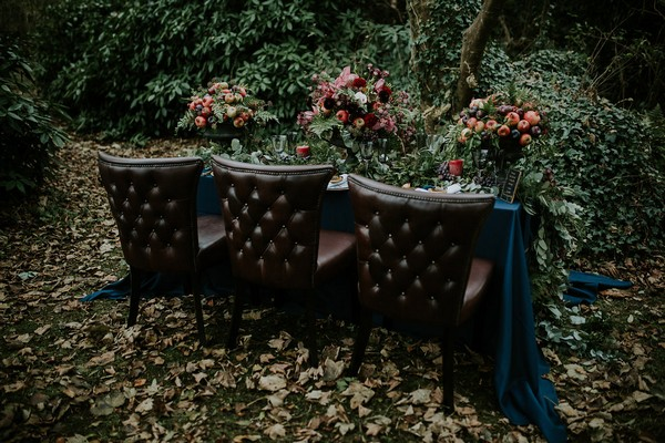 Leather chairs at wedding table