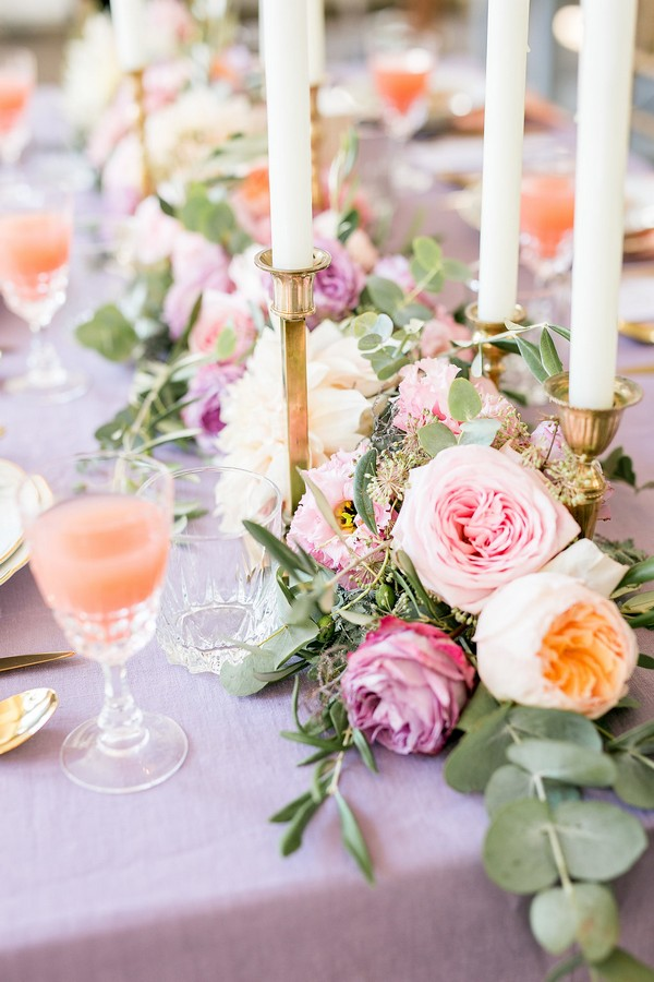 Violet and peach wedding table flowers