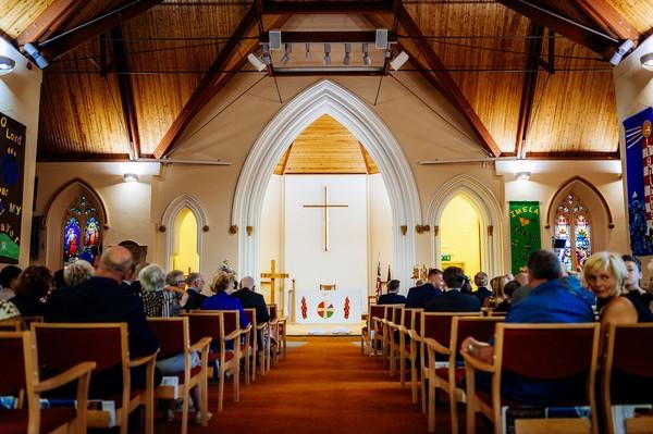 Wedding congregation inside St Luke's Church Crosby