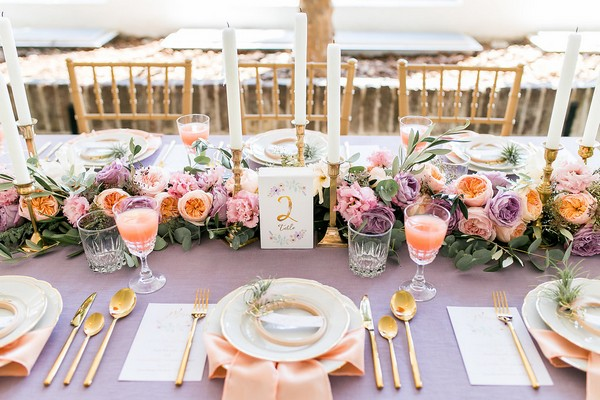 Violet and peach wedding table styling