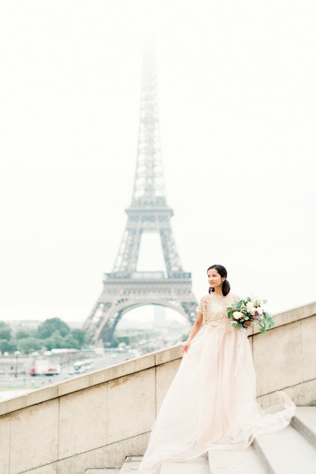 Bride holding bouquet with Eiffel Tower in background - Picture by Victoria JK Lamburn Photography