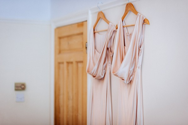 Bridesmaid dresses hanging on back of door