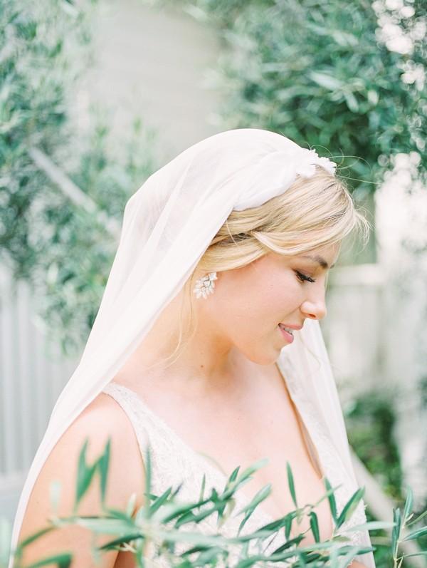 Side of bride's head showing earring