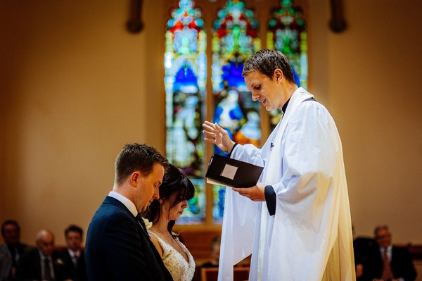 Vicar conducting wedding service
