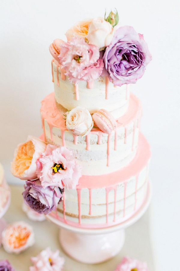 Drip wedding cake with violet and peach flowers
