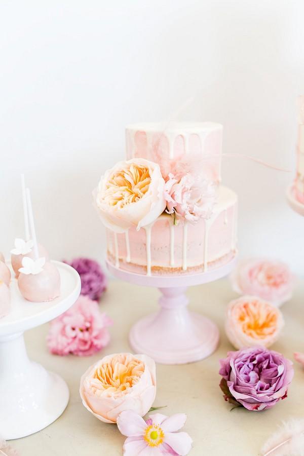Drip wedding cake with peach flowers