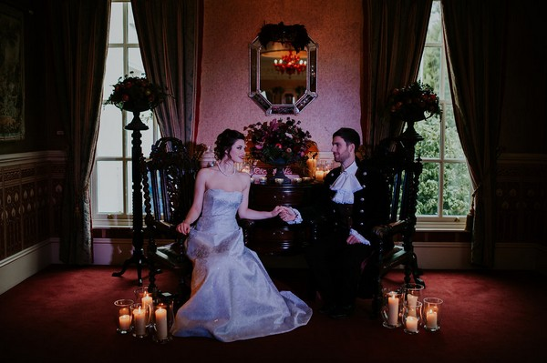 Bride and groom sitting in chairs in Penventon Park Hotel