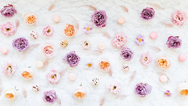 Violet and peach flowers with macarons