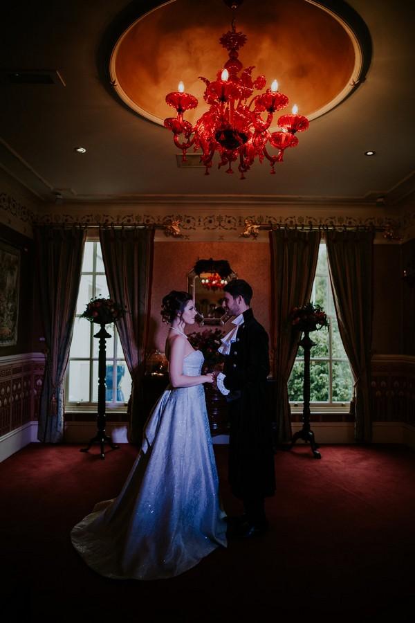Bride and groom standing under light in Penventon Park Hotel