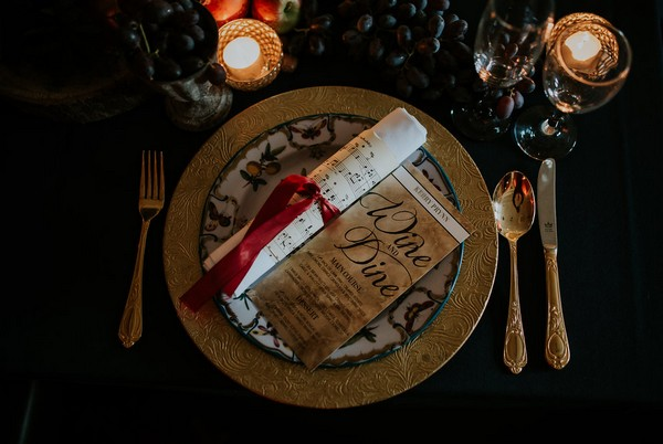 Wedding place setting with sheet music scroll and menu