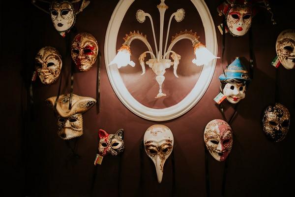 Venetian masks on wall at Penventon Park Hotel