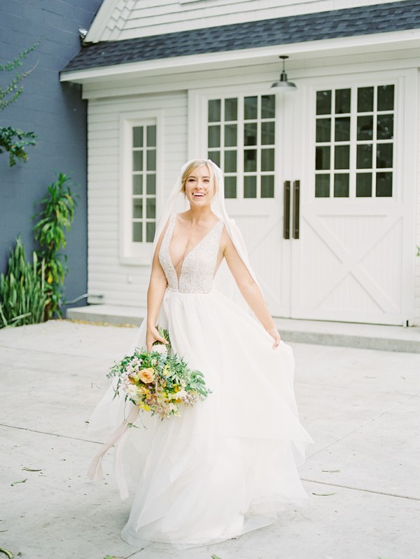 Bride holding out wedding dress
