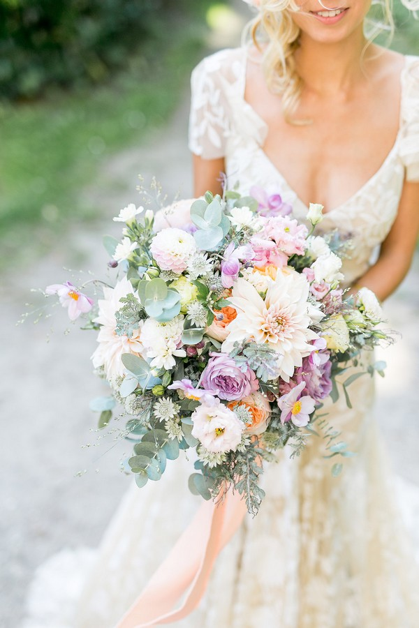 Bridal bouquet with violet, peach and white flowers