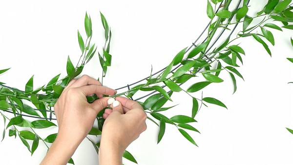 Attaching foliage to base of flower chandelier