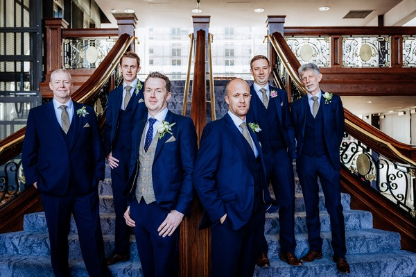Groomsmen on stairs inside Titanic Hotel Liverpool