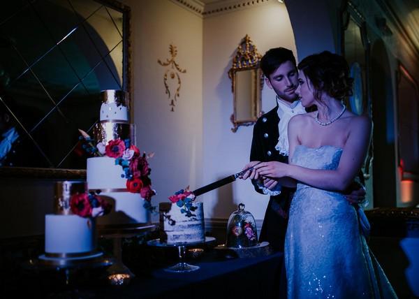 Bride and groom cutting wedding cake at Penventon Park Hotel