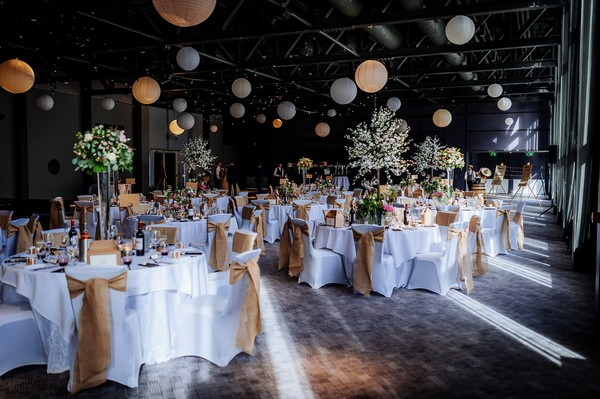 Rustic wedding styling in reception room at Titanic Hotel Liverpool