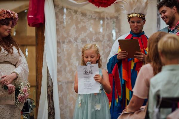 Flower girl doing wedding reading