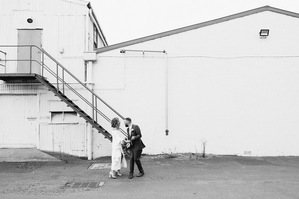 Bride and groom outside Gather and Tailor urban warehouse wedding venue