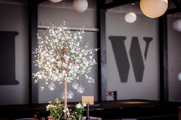 Tree with hanging tea lights on wedding table