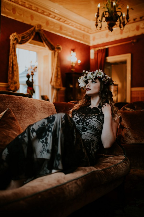 Bride with flower crown leaning back on couch