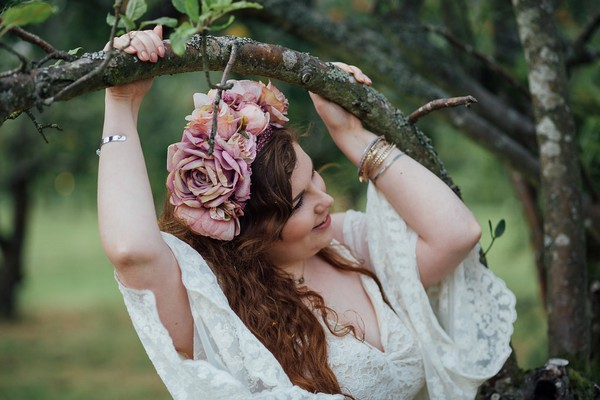 Bride holding on to tree branch
