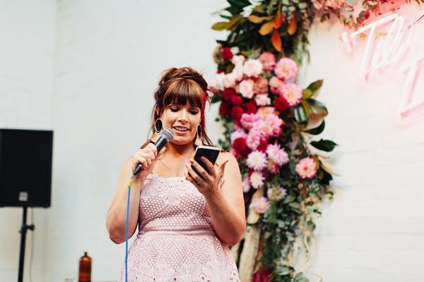 Bridesmaid reading speech on phone